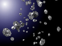 Falling diamonds. In the light on blue and black background Stock Photos