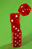 Falling dice. One die falls from the top Stock Photo