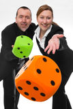 Falling  dice. Businesswoman and Businessman throwing two big dice Stock Images