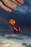 Falling dices. Hand throwing dices Royalty Free Stock Photo