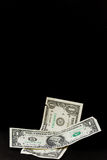 Falling dollar Stock Images