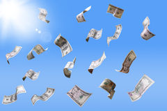 Falling dollar banknotes. Dollar banknotes falling from the sky Royalty Free Stock Photography