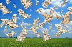 Falling dollars (field background). Falling dollars on green field background Stock Photography