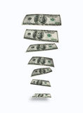 Falling dollars. Hundred dollars bank notes. On clear white background Stock Photography