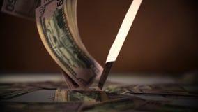 Falling dollars isolated on dark black background stock footage
