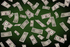 Falling dollars on the poker table Royalty Free Stock Photos