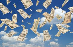 Falling dollars (sky background) royalty free stock photography