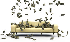Falling dollars on a sofa Stock Photo