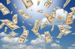 Falling dollars (sunny sky background). Falling dollars on sunny sky background Royalty Free Stock Photos