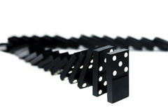 Falling domino. Domino pieces stand in a shape of corner Royalty Free Stock Photos