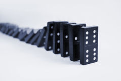 Falling domino Royalty Free Stock Images