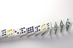 Falling dominoes Stock Images