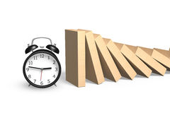 Falling dominoes with alarm clock Stock Images