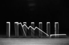 Falling dominoes. Alexandria , egypt , december 17 , 2016 : falling domino pieces with two exposures Stock Photography