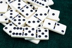 Falling dominoes. The domino game. Falling dominoes. Domino effect. The domino game stock photography