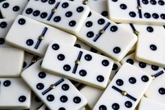 Falling dominoes. The domino game. Falling dominoes. Domino effect. The domino game royalty free stock photography