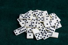 Falling dominoes. The domino game. Falling dominoes. Domino effect. The domino game stock image