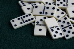 Falling dominoes. The domino game. Falling dominoes. Domino effect. The domino game royalty free stock photo