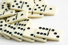 Falling dominoes. The domino game. Falling dominoes. Domino effect. The domino game royalty free stock photos