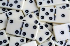 Falling dominoes. The domino game. Falling dominoes. Domino effect. The domino game stock images