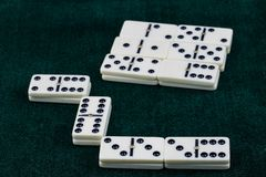 Falling dominoes. The domino game. Falling dominoes. Domino effect. The domino game stock photo