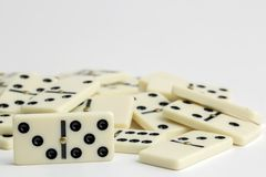 Falling dominoes. The domino game. Falling dominoes. Domino effect. The domino game stock photos