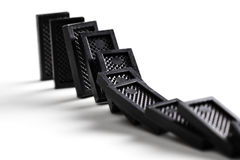 Falling dominoes Stock Photography