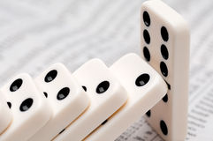Falling dominoes on a stock report Stock Image