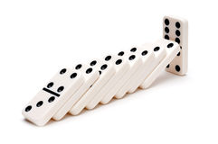 Falling dominoes on white Stock Images