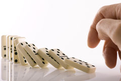 Falling dominos Stock Image