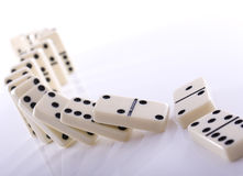 Falling dominos Stock Photo