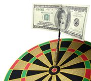 Falling down dollars. A 100$ note falls down on a dartboard royalty free stock images