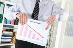 Falling down of economic activity Stock Photo