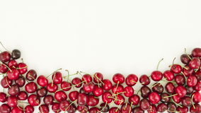 Falling down of fresh cherries, stop motion animation stock video footage
