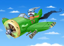 Falling down green airplane. The small green fighter plane with a rabbit in a cabin is falling down. The pilot is in a painc Stock Photos