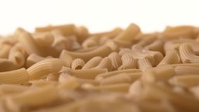 Falling down Italian pasta, on white, rotation stock video footage