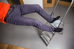 Falling down from ladder. Man is falling down from ladder at home Royalty Free Stock Image