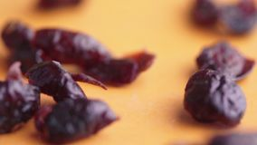 Falling dried cranberries in clow motion healthy. Snack stock video footage