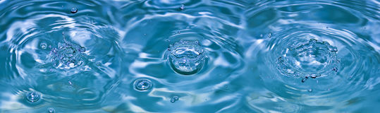 Falling drop of water Stock Photos