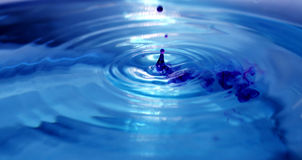 Falling drops. Of blue water in a basin stock photos