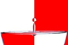 Falling drops of water on a white background red Stock Photo
