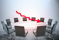 Falling earnings report. Conference table with a downward arrow graph - falling earnings report concept Royalty Free Stock Image