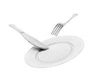 Falling empty white plate, knife and fork Stock Image