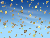 Falling euro coins. Fulling euro coins on blue sky background Royalty Free Stock Photography