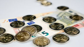 Falling Euro coins on paper currency. Falling Two Euro coins on paper currency - slow motion stock video footage