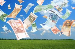 Falling euros (field background) Royalty Free Stock Image