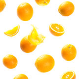 Falling and exploding ripe oranges Royalty Free Stock Photos