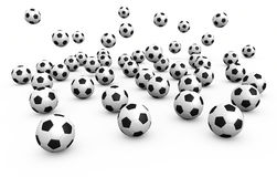 Falling football balls. A lot of falling football balls over white background. It is a 3D rendering concept Royalty Free Stock Image