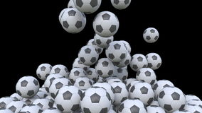 Falling football balls against black background. 3D rendering Royalty Free Stock Photos