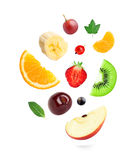 Falling fresh fruits and berries Stock Images